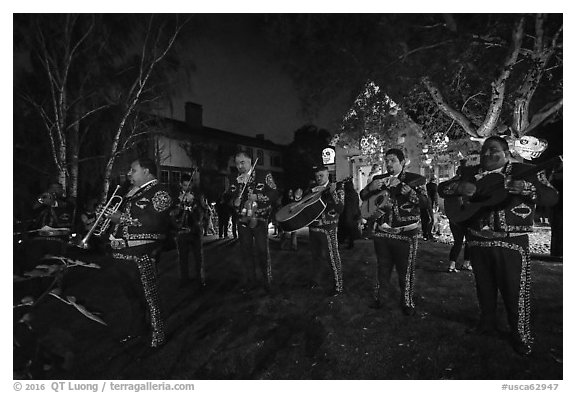 Mariachi musicians in front of decorated house. Petaluma, California, USA (black and white)