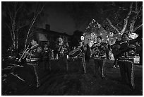 Mariachi musicians in front of decorated house. Petaluma, California, USA ( black and white)