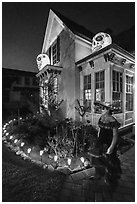 Woman in Halloween costume and decorated house. Petaluma, California, USA ( black and white)