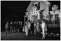 Family and guests pose in Halloween costumes. Petaluma, California, USA ( black and white)