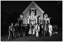 Halloween revelers and decorated house. Petaluma, California, USA ( black and white)