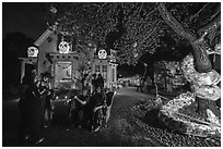Revelers in Halloween costumes in decorated yard. Petaluma, California, USA ( black and white)