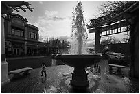 Fountain and plaza with child playing. Livermore, California, USA ( black and white)
