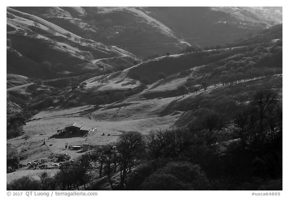 Distant view of barn in valley. Livermore, California, USA (black and white)