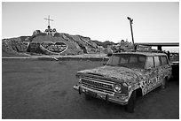 Painted car and Salvation Mountain. Nyland, California, USA ( black and white)