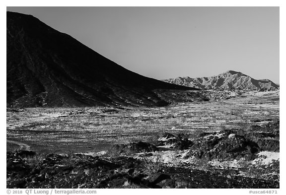 Lava field, Amboy Crater slope and mountains. Mojave Trails National Monument, California, USA (black and white)