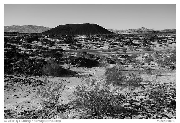 Volcanic terrain with Amboy Crater extinct cinder cone volcano. Mojave Trails National Monument, California, USA (black and white)