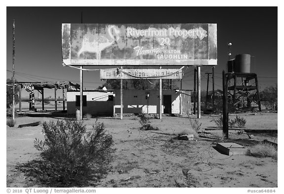 Old billboard and abandonned gas station. Mojave Trails National Monument, California, USA (black and white)