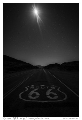Route 66 marking and moon at night. Mojave Trails National Monument, California, USA (black and white)