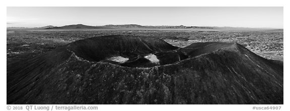 Aerial panoramic view of Amboy Crater and Bullion Mountains at sunrise. Mojave Trails National Monument, California, USA (black and white)