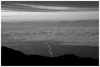 Low clouds above Los Angeles at sunrise from Mount Wilson. Los Angeles, California, USA ( black and white)