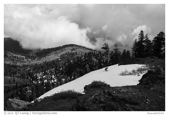 Snow patch and storm cloud near Snow Mountain summit. Berryessa Snow Mountain National Monument, California, USA (black and white)