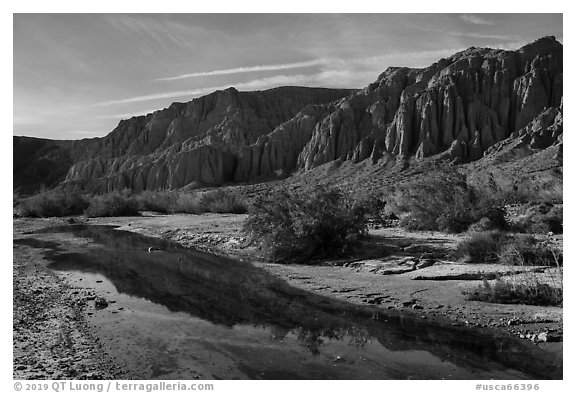 Afton Canyon cliffs reflected in shallow Mojave River. Mojave Trails National Monument, California, USA (black and white)