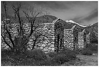 Ruined stone cabins and San Giorgono Mountain. Sand to Snow National Monument, California, USA ( black and white)