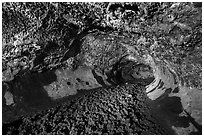 Lava tube with lumpy lava floor, Golden Dome Cave. Lava Beds National Monument, California, USA ( black and white)
