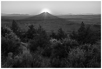 Whitney Butte with sun setting. Lava Beds National Monument, California, USA ( black and white)