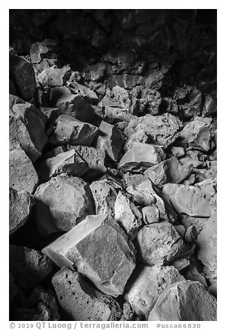 Colored rocks from collapsed ceilling, Big Painted Cave. Lava Beds National Monument, California, USA (black and white)