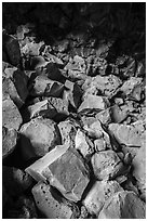 Colored rocks from collapsed ceilling, Big Painted Cave. Lava Beds National Monument, California, USA ( black and white)