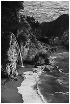 McWay waterfall flowing on beach, Julia Pfeiffer Burns State Park. Big Sur, California, USA ( black and white)