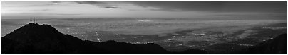 Foggy Los Angeles Basin from Mount Wilson at sunrise. Los Angeles, California, USA (Panoramic black and white)