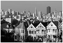 Victorians at Alamo Square and skyline, afternoon. San Francisco, California, USA (black and white)