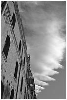 Old brick building and serrated cloud, sunset, Fisherman's Wharf. San Francisco, California, USA ( black and white)
