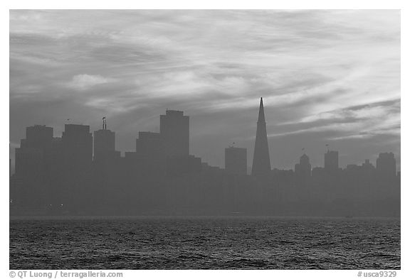 City skyline with sunset clouds seen from Treasure Island. San Francisco, California, USA (black and white)