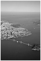 Aerial view of the Bay Bridge, the city, and  the Golden Gate Bridge. San Francisco, California, USA ( black and white)