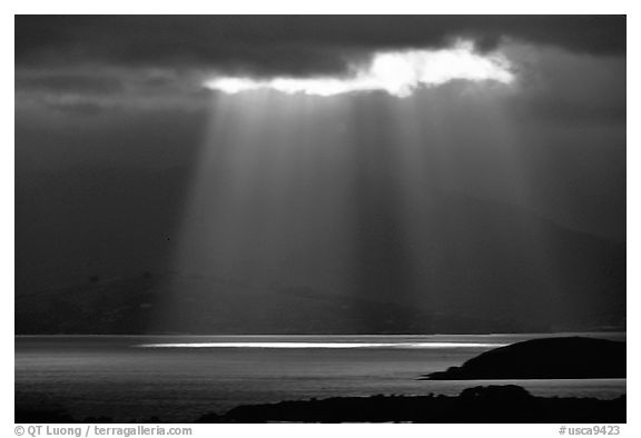 Sunbeams above the Golden Gate, seen from the Berkeley Hills. Berkeley, California, USA (black and white)