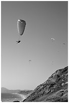 Paragliding above a sea cliff, the Dumps, Pacifica. San Mateo County, California, USA ( black and white)