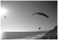 Paragliders soaring above the Ocean, the Dumps, Pacifica. San Mateo County, California, USA ( black and white)