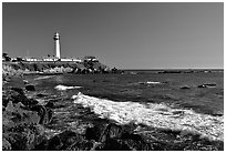 Wave and Pigeon Point Lighthouse, afternoon. San Mateo County, California, USA ( black and white)