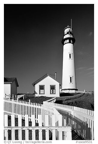 Fence and Pigeon Point Lighthouse, afternoon. San Mateo County, California, USA (black and white)