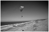 Paragliders soaring above Marina sand dunes. California, USA ( black and white)