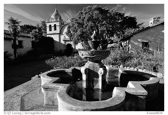 Fountain and chapel, Carmel Mission. Carmel-by-the-Sea, California, USA (black and white)