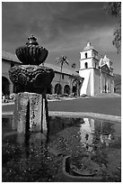 Fountain and Mission Santa Babara, mid-day. Santa Barbara, California, USA ( black and white)