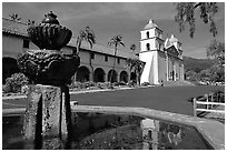 Fountain and Mission Santa Babara, mid-day. Santa Barbara, California, USA (black and white)
