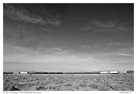 Long train in the Mojave desert. California, USA (black and white)