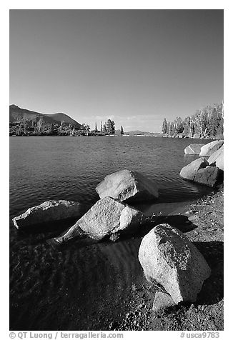 Boulders at the edge of Frog Lake, afternoon. Mokelumne Wilderness, Eldorado National Forest, California, USA (black and white)