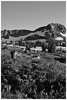 Hiker on trail towards Round Top, late afternoon. Mokelumne Wilderness, Eldorado National Forest, California, USA (black and white)