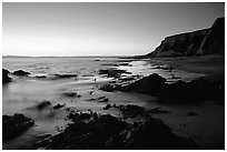 Rocks and surf, Sculptured Beach, sunset. Point Reyes National Seashore, California, USA ( black and white)