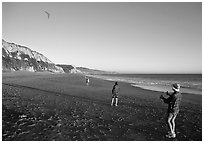 Flying a kite at Santa Maria Beach, late afternoon. Point Reyes National Seashore, California, USA (black and white)