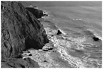 Cliffs, waves,  and Point Bonita Lighthouse, late afternoon. California, USA ( black and white)