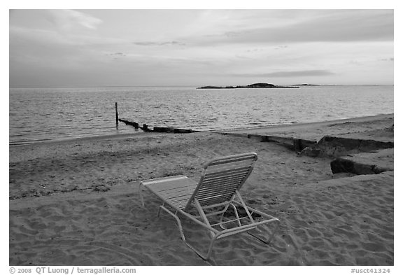 Beach chair at sunset, Westbrook. Connecticut, USA (black and white)