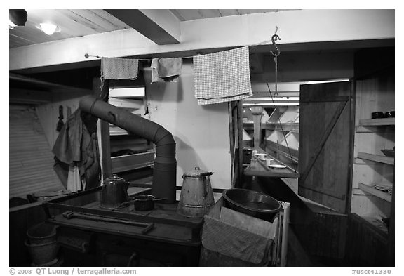Kitchen and dining room on historic ship. Mystic, Connecticut, USA (black and white)