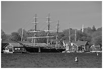 Three masted ship, Mystic River, and church. Mystic, Connecticut, USA ( black and white)