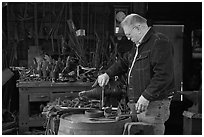 Man in ironwork shop. Mystic, Connecticut, USA (black and white)