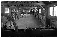 Fibers being spun into yards, Ropewalk. Mystic, Connecticut, USA ( black and white)