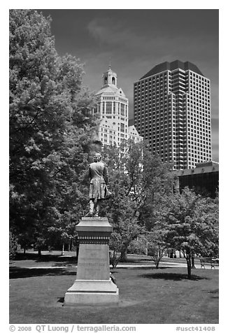 Statue in park and high-rise buildings. Hartford, Connecticut, USA (black and white)