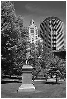 Statue in park and high-rise buildings. Hartford, Connecticut, USA ( black and white)